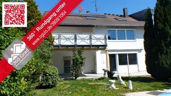 Mehrfamilienwohnhaus mit Gewerbe in Freiburg